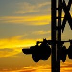 railroad crossing with sunset