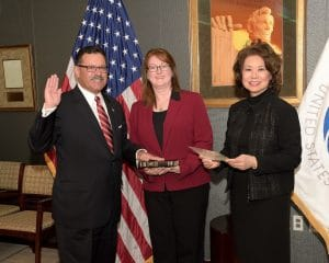 U.S. Secretary of Transportation Elaine L. Chao swears in Raymond P. Martinez as administrator of the Federal Motor Carriers Safety Administration. From left are Martinez, Martinez's wife, Marin Gibson, and Chao. (PRNewsfoto via Federal Motor Carrier Safety Administration)