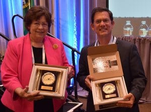 Washington state Reps. Marilyn Chase and Mark Miloscia show off the awards they received from the Washington State Legislative Board at the Seattle Regional Meeting.