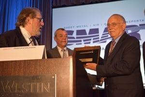 Washington state Sen. John Conway accepts his Golden Spike award from Washington State Legislative Director Herb Krohn, left, and SMART TD President John Previsich, center, at the Seattle Regional Meeting.