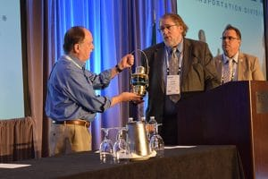 Washington state Rep. Mike Sells, left, accepts a Golden Lantern award from Washington State Legislative Director Herb Krohn at the Seattle Regional Meeting.
