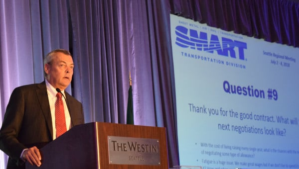Transportation Division President John Previsich addresses the closing session of the SMART TD Regional Meeting in Seattle on July 4.